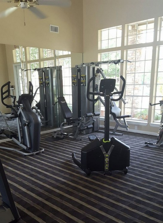 View of apartment gym area with exercise equipment