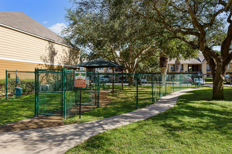 View of fenced dog park and pet station