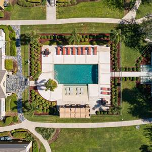 Swimming pool with lounge chairs and tanning deck. Click for photo gallery.