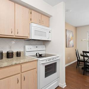 View of apartment kitchen and dining area with light fixtures.. Click for photo gallery.