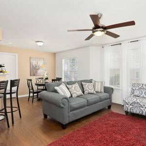 Apartment living room with wood look floor and furniture. Click for photo gallery.