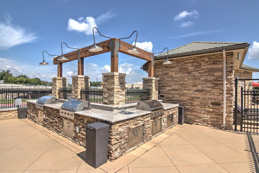 Outdoor kitchen with stainless steel grills