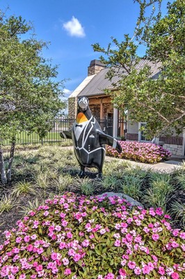 Penguin statue in garden. Click to view the photo gallery.