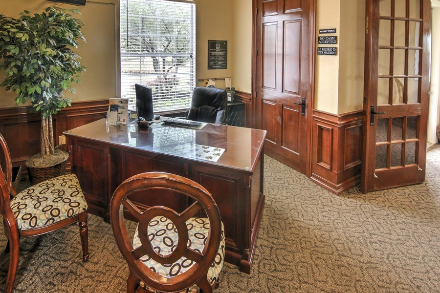 Leasing office with desk and chairs
