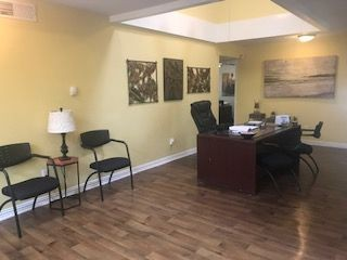 Leasing office with desk and chairs. Click to view the photo gallery.