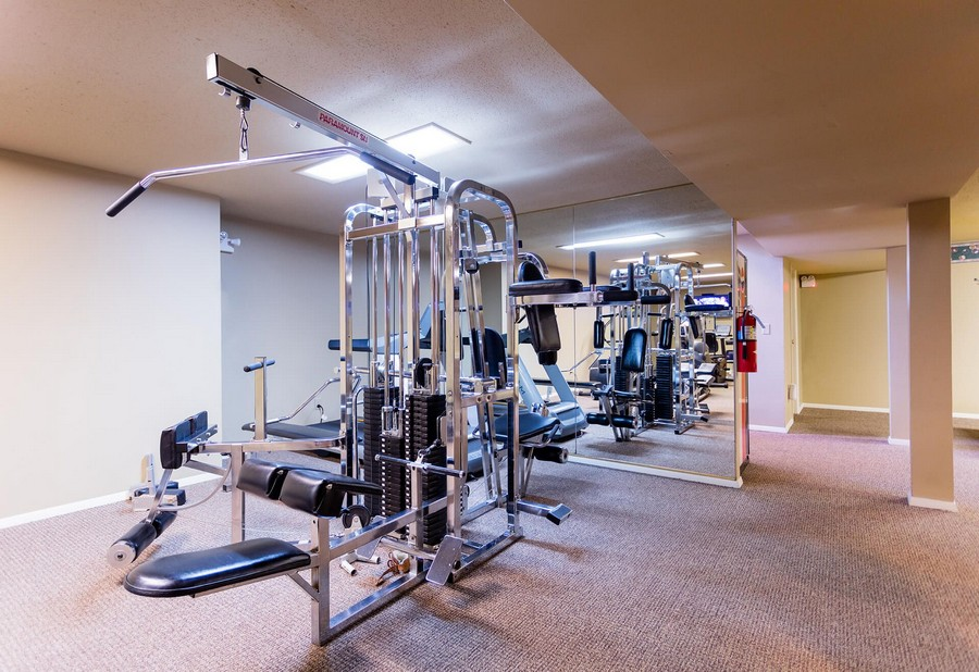 Apartment gym with different weight equipment