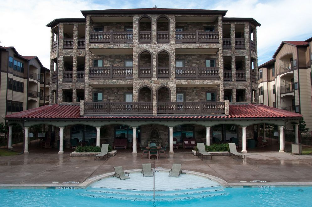 Outside view of apartment building and swimming pool