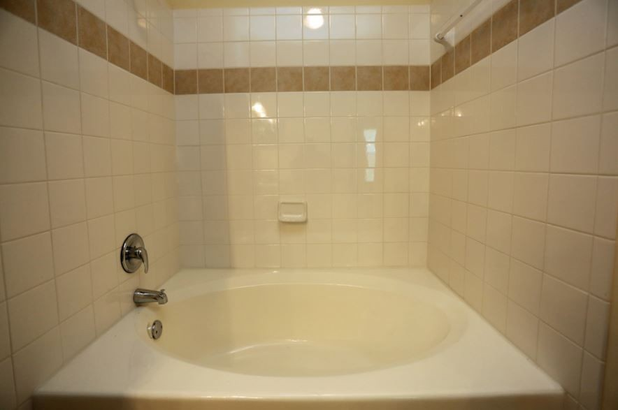 Soaking tub in apartment bathroom