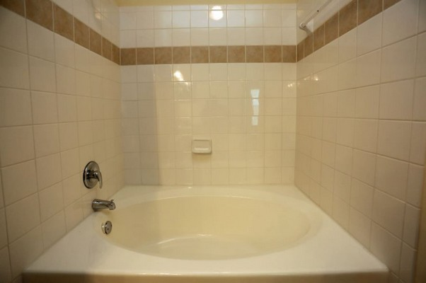 Soaking tub in apartment bathroom. Click to view the photo gallery.