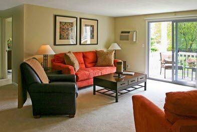 Apartment living room with couches and center table. Click to view the photo gallery.