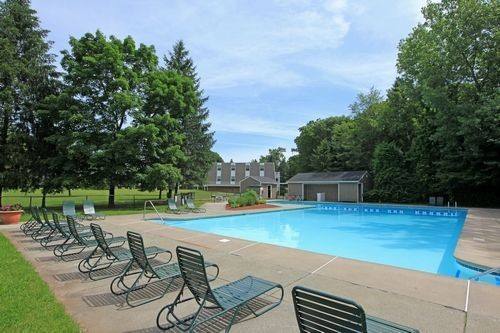 Outdoor pool with pool chairs. Click to view the photo gallery.