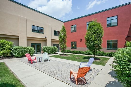 Courtyard with seating area. Click to view the photo gallery.