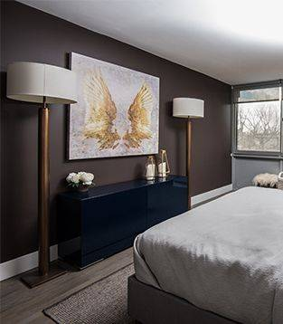 bedroom with angel wing wall art