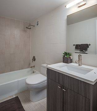 bath room with tile floor and bathtub
