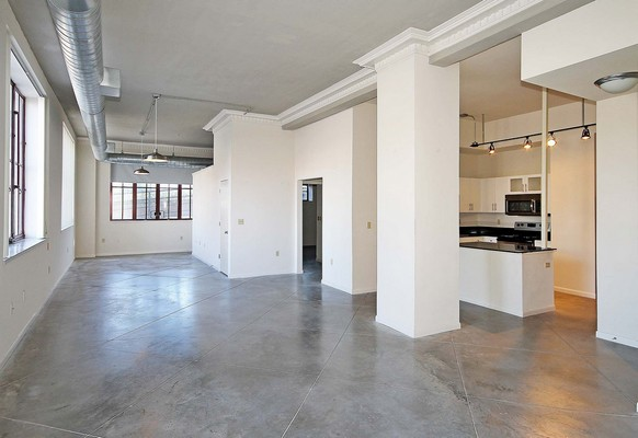 Apartment living area and kitchen. Click to view the photo gallery.