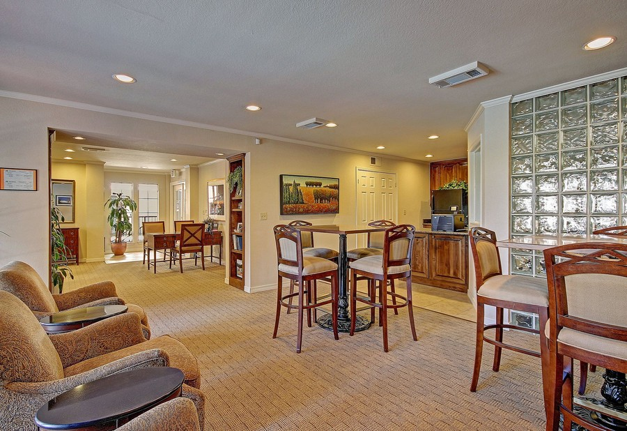 Resident clubhouse with seating and kitchen