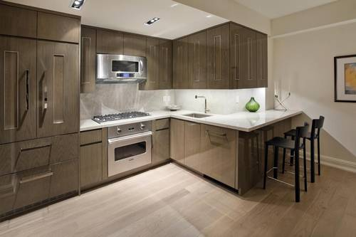 rendering of kitchen with breakfast bar and stainless steel appliances