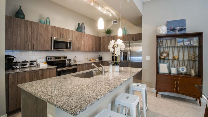 Apartment kitchen with stainless steel appliances. Click to view the photo gallery.