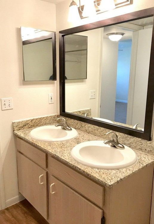 Dual vanity in apartment bathroom