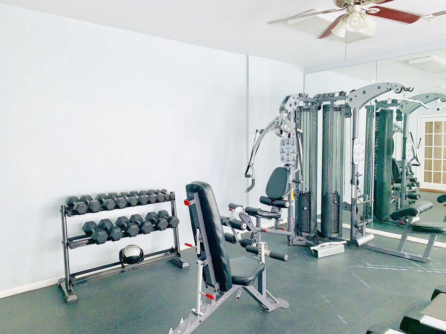 Fitness center with weight lifting equipment