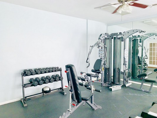 Fitness center with weight lifting equipment. Click to view the photo gallery.