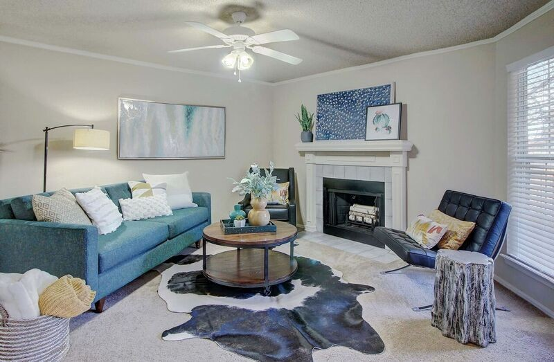 Apartment living area with seating and fireplace