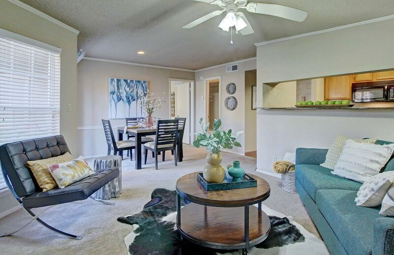 Apartment living area with seating and view of dining area