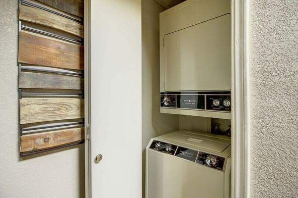 Stacked washer and dryer in apartment. Click to view the photo gallery.