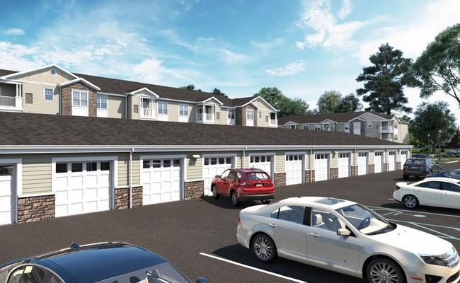 Rendering of apartment building and attached garages. Click to view the photo gallery.