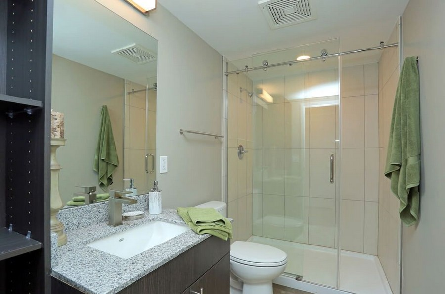 Bathroom with walk-in shower and vanity