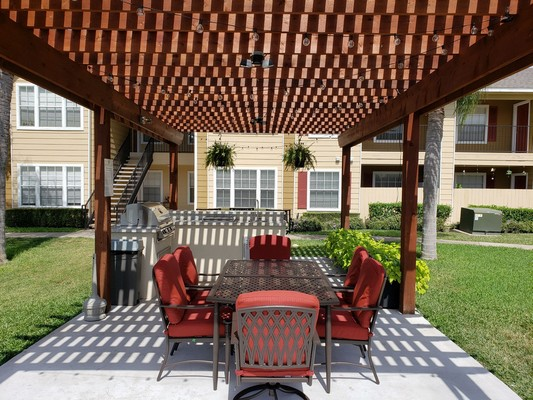 Patio table and chairs under a gazebo . Click to view the photo gallery.