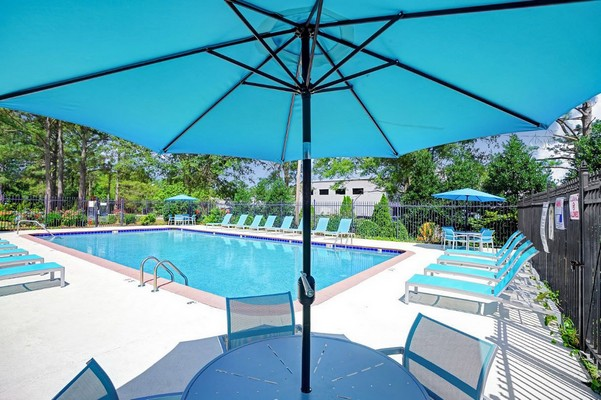 Swimming pool with seating and covered area. Click to view the photo gallery.