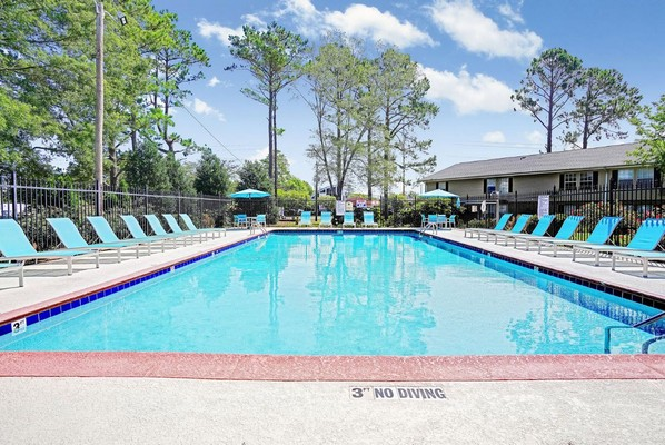 Swimming pool with seating. Click to view the photo gallery.