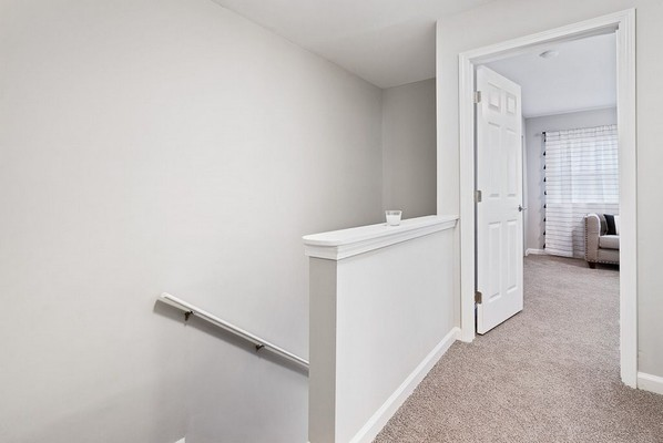 View of bedroom entrance and staircase. Click to view the photo gallery.