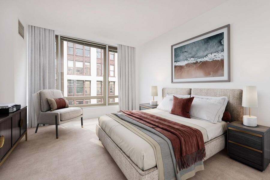 apartment bedroom with plush carpet and expansive windows