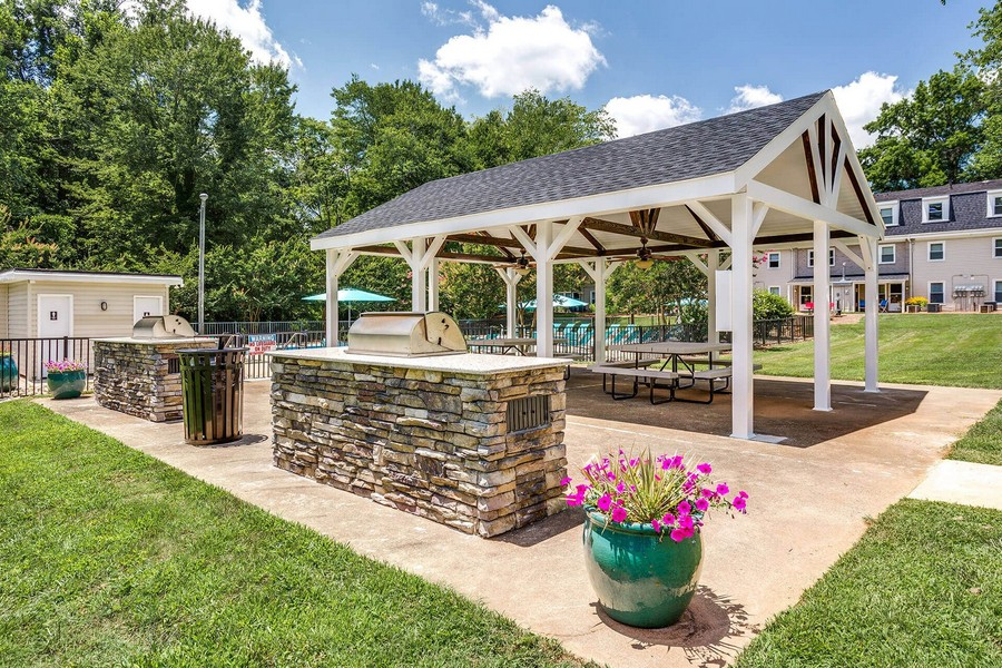 Outdoor picnic area with grills and seating