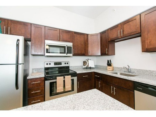 kitchen cabinetry and counters that line two walls. Click to view the photo gallery.