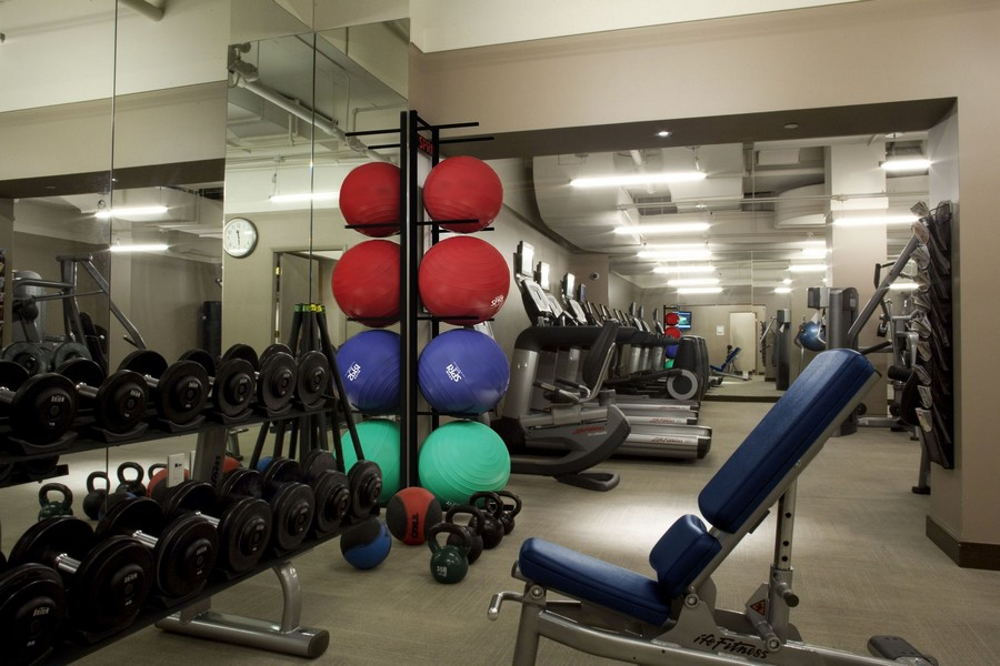fitness center with weights and yoga balls