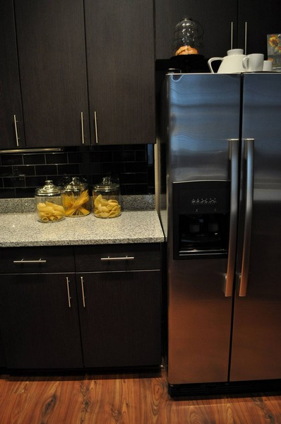 Stainless steel refrigerator next to kitchen counter
