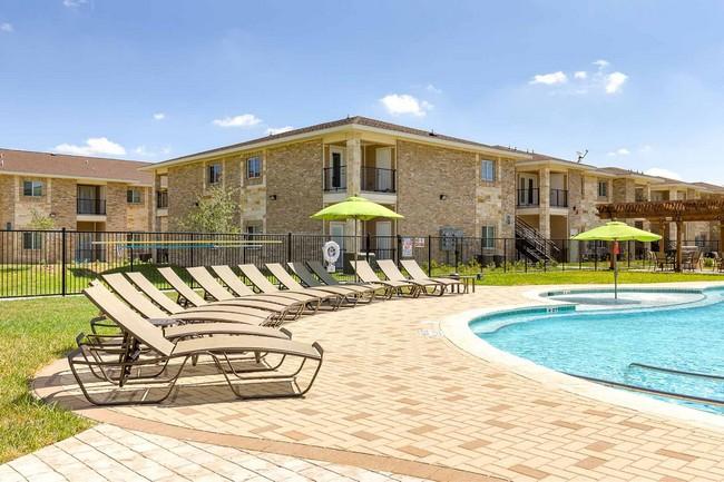 sunbathing area located next to pool