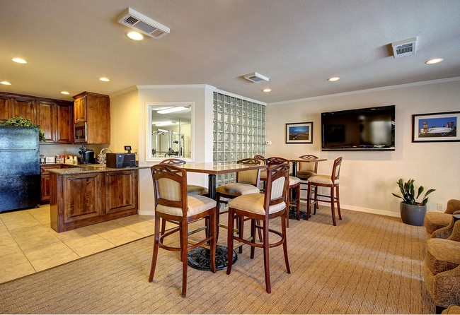 Clubhouse with kitchen and tables and chairs