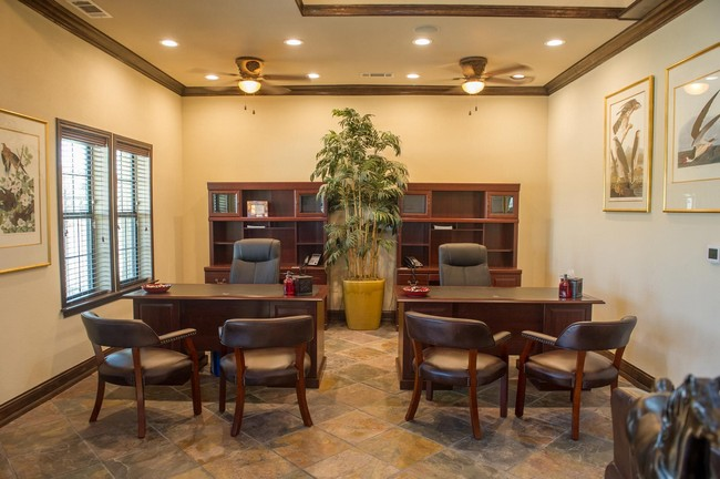 Leasing office with desks and chairs