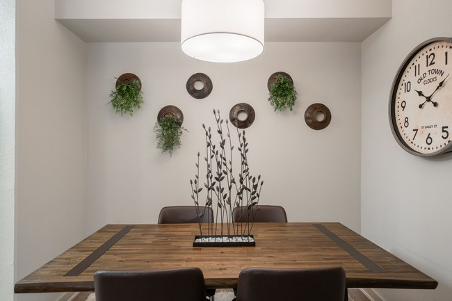 Table with chairs and large clock on wall