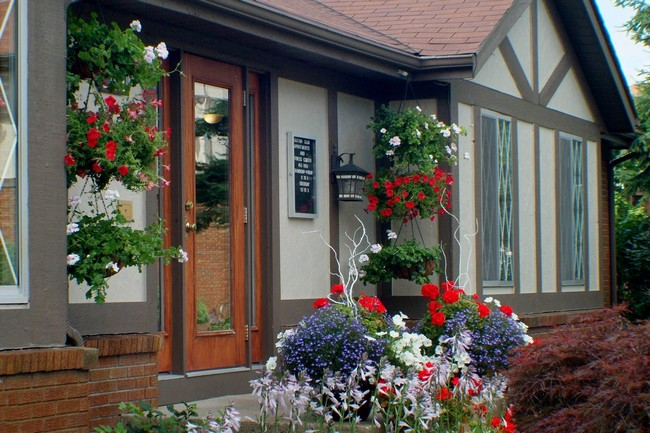 Outside view of the building with hanging flower baskets