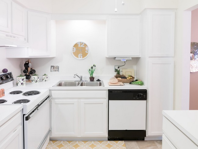 Kitchen with white cabinets and dishwasher