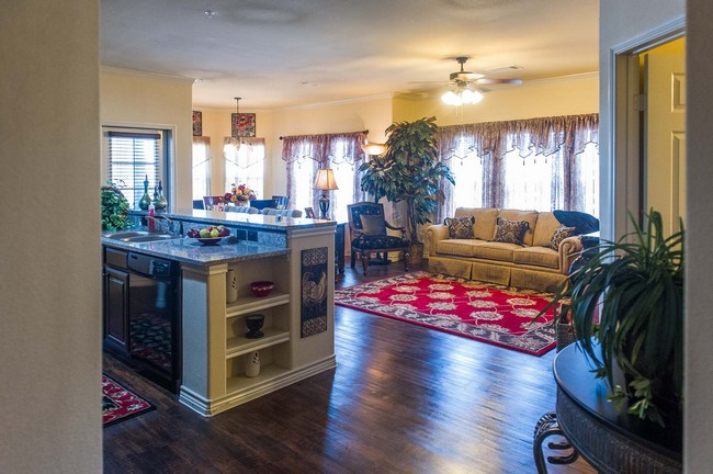 Furnished apartment with kitchen and view of living room