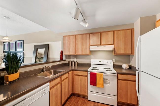 Apartment kitchen with white appliances