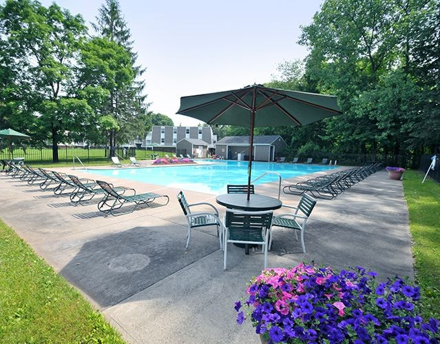 Outdoor pool with beach chairs
