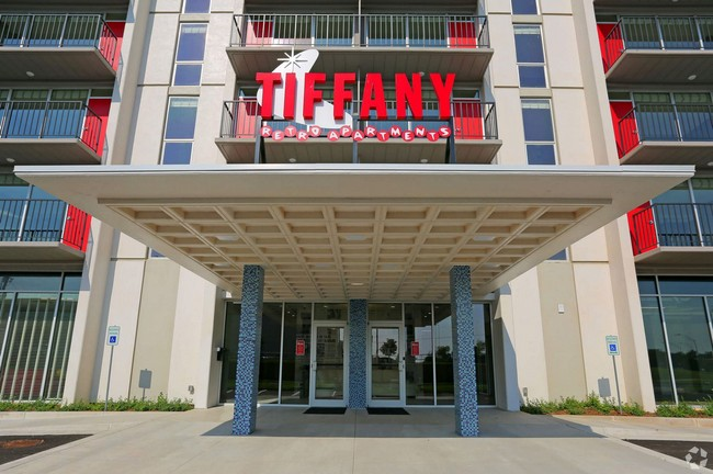 Entryway with large sign reading Tiffany Apartments
