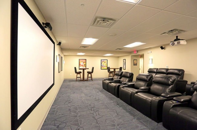 Theater room with reclining chairs